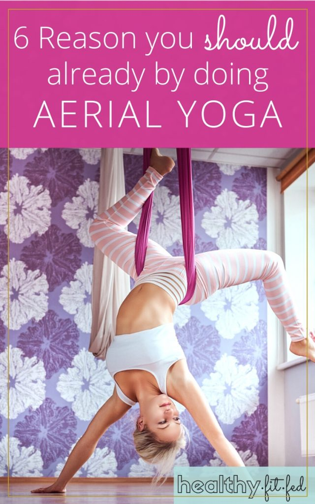 reasons you should already be doing aerial yoga, woman in yoga hammock hanging