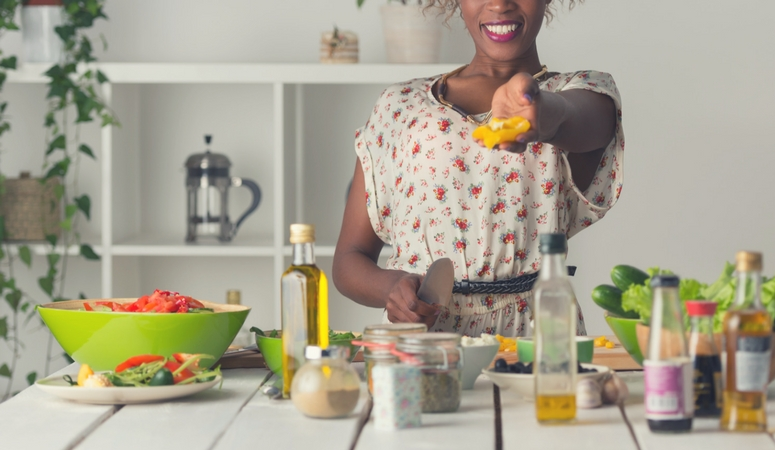 woman cooking in kitchen clean and healthy foods