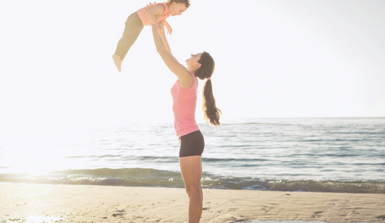 Workout with toddler backyard lifts